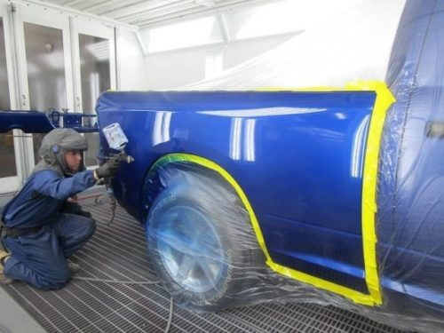painting a truck blue at Bates Collision